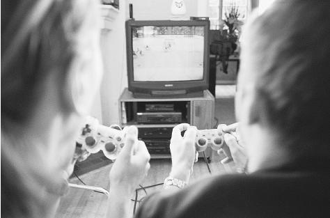Sixty percent of the audience for interactive games, like this video hockey game, are children. The electronic gaming industry has voluntarily begun to rate its products, although rating labels and advisories are widely ignored by distributors and retailers. CORBIS