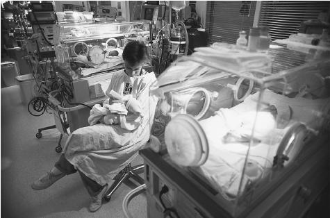 The neonatal intensive care unit in hospitals, certainly a foreign and technical environment to non-medical personnel such as parents, is one that many parents have to visit when their child's life is in danger. Unfortunately in less-developed nations, parents whose infant children die do not have the opportunity or funds to invest in this type of technological care. CORBIS (BELLEVUE)