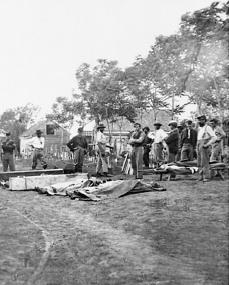 Union soldiers prepare to bury dead soldiers that are underneath tarps. Excluding the Vietnam War, Civil War deaths nearly equaled the number of deaths in all otherwars in U.S. history combined. LIBRARY OF CONGRESS