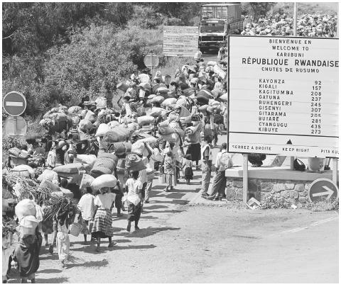 In 1996 Rwandan Hutu refugees return home after having fled to Tanzania in 1994 fearing the retribution for a Hutuplanned genocide of the minority Tutsis. The Rwandan genocide stands as an event that could have been prevented had there been a will by the United Nations and other great powers to intervene. AP/WIDE WORLD PHOTOS