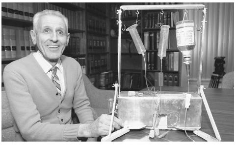 "Jack Kevorkian sits with his ""suicide machine,"" a device consisting of tubes, hypodermic needles, saline solution, a muscle relaxant, and a lethal drug. AP/WIDE WORLD PHOTOS"