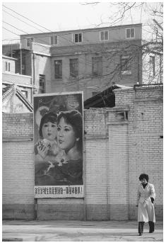"Female children were once considered a social stigma in China where ""one-child"" policies existed, and infanticide was common if a woman gave birth to a baby girl. With the hopes of curtailing infanticide rates, billboard posters in the community still encouraged ""one-child"" policies, but said that it was acceptable to have daughters. OWEN FRANKEN/CORBIS"