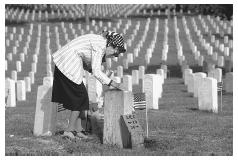 Visiting the cemetery on Veterans' Day, a war widow polishes the marble of her husband's gravestone. JOSEPH SOHM, CHROMOSOHM INC./CORBIS