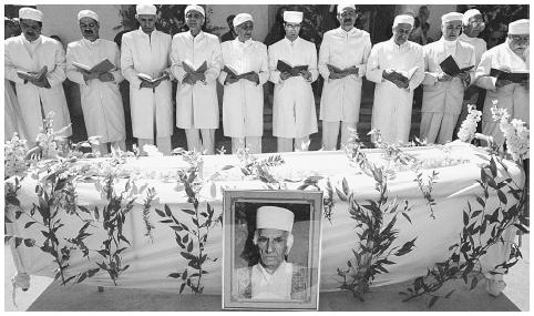Zoroastrianism originated in ancient Iran sometime around 2000 B.C.E. In March 2000 at the Zoroastrian Qasr-e-Firoozeh cemetery in Teheran, Zoroastrian priests prayed at the funeral of the religious leader of the Iranian Zoroastrian community, Dastur Rostam Dinyar Shahzadi. AFP/CORBIS